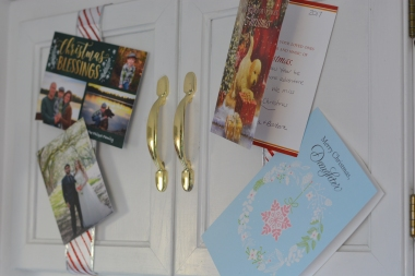 cards displayed on cabinets, attached to xmas ribboon